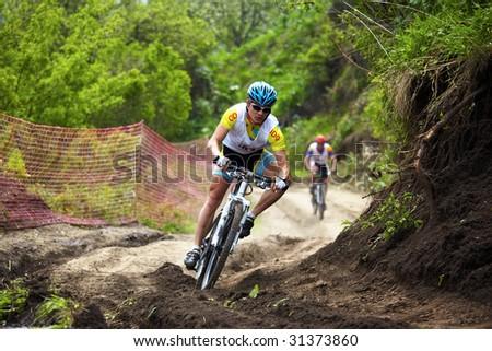 ALMATY, KAZAKHSTAN - MAY 23: Kirill Kazantsev in action at cross-country mountain bike race Mercur Open Cup May 23, 2009 in Almaty, Kazakhstan.