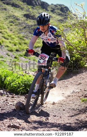 "ALMATY, KAZAKHSTAN - MAY 2: M.Budko (N30) in action at Adventure mountain bike cross-country marathon in mountains ""Jeyran Trophy 2011"" on May 2, 2011 in Almaty, Kazakhstan."
