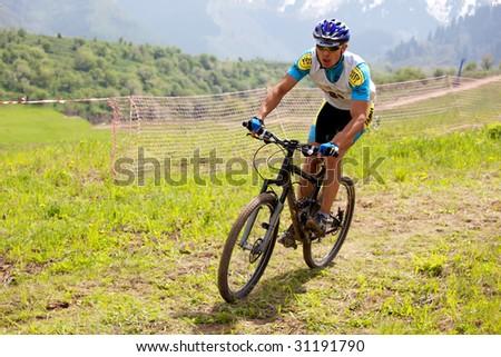 ALMATY, KAZAKHSTAN - May 23: Nurjan Tlegenov in action at cross-country mountain bike race Mercur Open Cup in Almaty , Kazakhstan May 23, 2009.