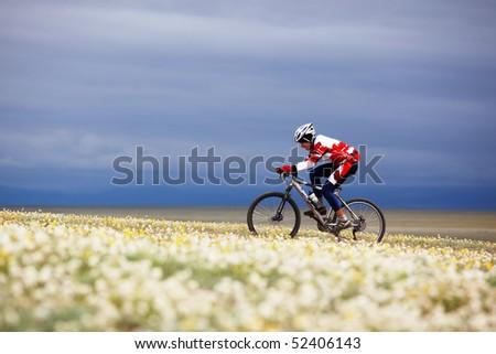"ALMATY, KAZAKHSTAN - MAY 2: R.Fayzullin (N17) in action at Adventure mountain bike cross-country marathon in mountains ""Jeyran Trophy 2010"" May 2, 2010 in Almaty, Kazakhstan."