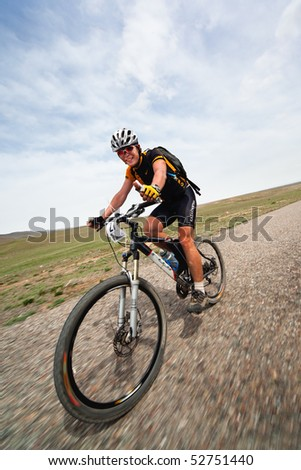 "ALMATY, KAZAKHSTAN - MAY 1: V.Marchenko (N27) in action at Adventure mountain bike cross-country marathon in mountains ""Jeyran Trophy 2010"" May 1, 2010 in Almaty, Kazakhstan."