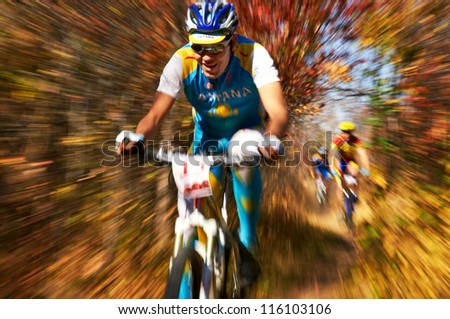 ALMATY, KAZAKHSTAN - OCTOBER 14: A.Anfinogenov (N15) in action at cross-country mountain bike 'Apple race' October 14, 2012 in Almaty, Kazakhstan.