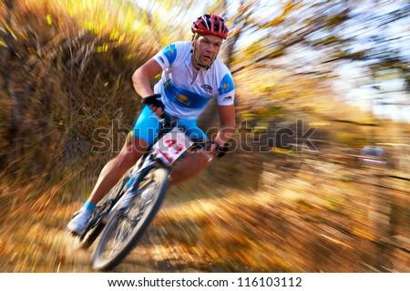 ALMATY, KAZAKHSTAN - OCTOBER 14: G.Krupnyakov (N43) in action at cross-country mountain bike 'Apple race' October 14, 2012 in Almaty, Kazakhstan.