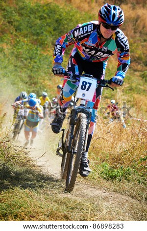 ALMATY, KAZAKHSTAN - OCTOBER 16: I. Feodoseev (No. 87) in action at cross-country mountain bike 'Apple race' on October 16, 2011 in Almaty, Kazakhstan.