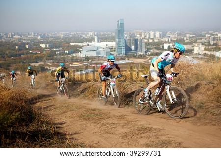 ALMATY, KAZAKHSTAN - OCTOBER 18: Riders in action at cross-country mountain bike 'Apple race' October 18, 2009 in Almaty , Kazakhstan.
