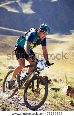 "ALMATY, KAZAKHSTAN - SEPTEMBER 05: An unidentified in action at Adventure mountain bike cross-country marathon ""Marathon Bartogay-Assy-Batan 2010"" on September 05, 2010 in Almaty, Kazakhstan."