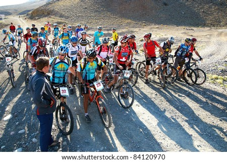 "ALMATY, KAZAKHSTAN - SEPTEMBER 04: Competitors preparing for start in action at Adventure mountain bike cross-country marathon ""Marathon Bartogay-Batan 2011"" September 04, 2011 in Almaty, Kazakhstan."