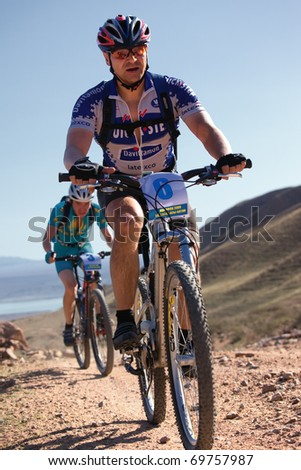 "ALMATY, KAZAKHSTAN - SEPTEMBER 13: Igor Baranov (N6) in action at Adventure mountain bike marathon in mountains ""Marathon Bartogay-Assy-Batan 2009""  September 13, 2009 in Almaty, Kazakhstan."