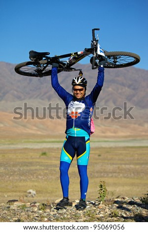 "ALMATY, KAZAKHSTAN - SEPTEMBER 13: Ildar Junusov (N11) before start at Adventure mountain bike cross-country marathon ""Marathon Bartogay-Assy-Batan 2009"" on September 13, 2009 in Almaty, Kazakhstan."