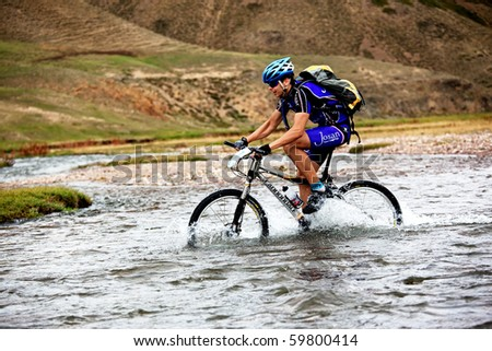 "ALMATY, KAZAKHSTAN - SEPTEMBER 13: Ivan Popov (N7) in action at Adventure mountain bike cross-country marathon ""Marathon Bartogay-Assy-Batan 2009"" on September 13, 2009 in Almaty, Kazakhstan."