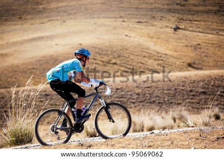 "ALMATY, KAZAKHSTAN - SEPTEMBER 13: M.Dzolba (N13) in action at Adventure mountain bike cross-country marathon ""Marathon Bartogay-Assy-Batan 2009"" on September 13, 2009 in Almaty, Kazakhstan."