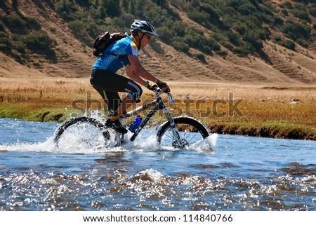 "ALMATY, KAZAKHSTAN - SEPTEMBER 09: M.Sotnikov (N5) in action at Adventure mountain bike cross-country marathon ""Marathon Bartogay-Assy-Batan 2012"" on September 09, 2012 in Almaty, Kazakhstan."