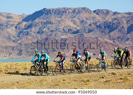 "ALMATY, KAZAKHSTAN - SEPTEMBER 13: Mountain bikers in action at Adventure mountain bike cross-country marathon ""Marathon Bartogay-Assy-Batan 2009"" on September 13, 2009 in Almaty, Kazakhstan."