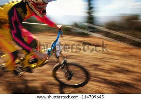 "ALMATY, KAZAKHSTAN - SEPTEMBER 16: Unknown rider  in action at ""Open Championship in Almaty - DOWNHILL"" in Almaty, Kazakhstan, September 16, 2012. - stock photo"