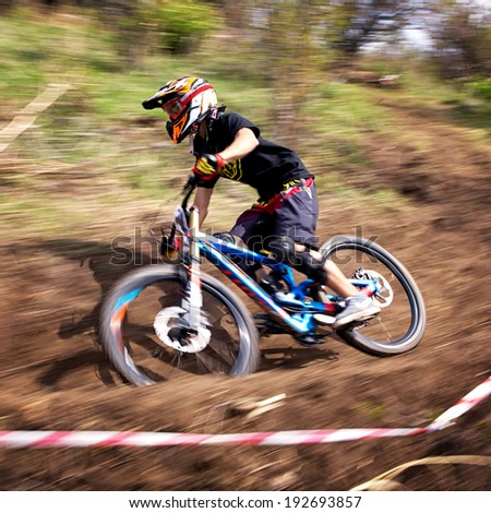 ALMATY, KAZAKSTAN - APRIL 27, 2014: Unknown rider in action at Mountain Bike sports event Downhill Koktybe.