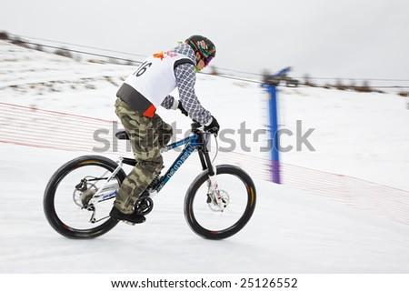 Almaty, Kazakstan - February 15: Red Bull Snow BikeCross, February 15, 2009 in Almaty, Kazakstan. Competitor Jomart Kemakbaev N16
