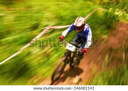 ALMATY, KAZAKSTAN - JUNE 30: D.Gusenkov (N3) in action at Mountain Bike sports event dedicated to the Day of the capital in Almaty, Kazakstan JUNE 30, 2013.