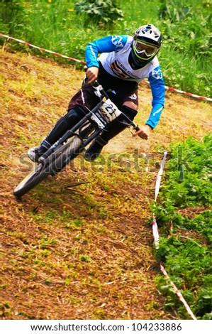 ALMATY, KAZAKSTAN - MAY 26: S.Zakirov (N21) in action at Freestyle Mountain Bike Session in Almaty, Kazakstan MAY 26, 2012.