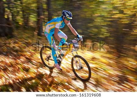ALMATY REGION, KAZAKHSTAN - OCTOBER 13: Y.Shkerdin (N193) in action at  mountain bike sports event \