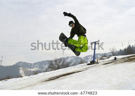 Almaty. Snowboarder jumping on the bigair in the Tien Shan