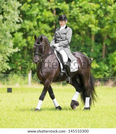 stock-photo-almere-july-equestrian-esther-liano-demonstrates-her-horse-riding-skills-in-upper-level-145510300.jpg