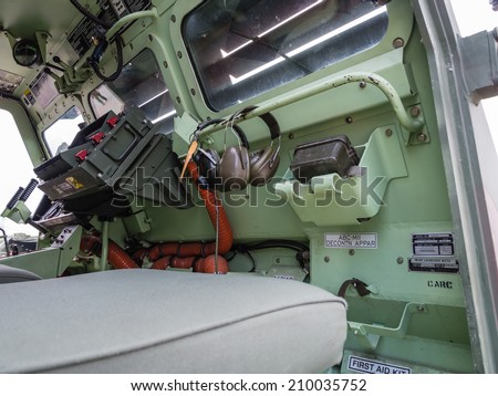 ALMERE, NETHERLANDS - 23 APRIL 2014: Inside the fron of a Dutch military  vehicle on display during the National Army Day in Almere
