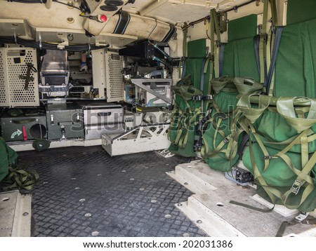 ALMERE, NETHERLANDS - 12 APRIL 2014: Look inside the rear of a military vehicle on display during the first National Security Day held in the city of Almere