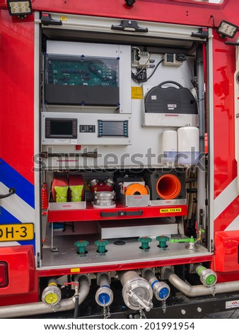 ALMERE, NETHERLANDS - 12 APRIL 2014: Part of the interior of a modern Dutch fire engine showing tools and equipment on display during the first National Security Day held in the city of Almere
