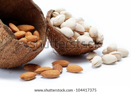 Almond and pistachio nuts in the shell of the coconut.