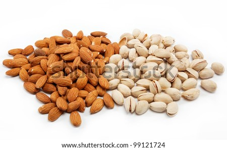 Almond and pistachio nuts on the white.