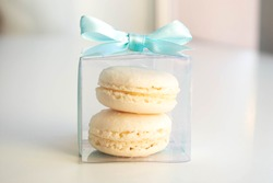 almond cakes in a transparent box with a blue ribbon