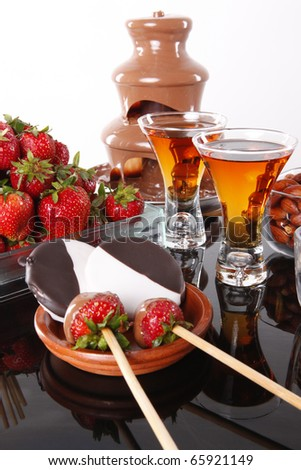Almond liquor and strawberry chocolate fondue - stock photo