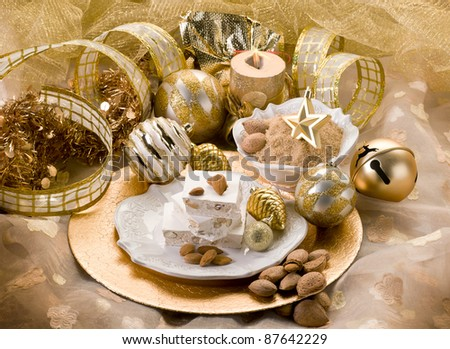 almond nougat aver christmas table - stock photo