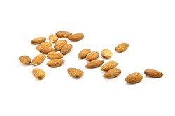 Almond nuts isolated on white background. Heap of scattered almond nuts