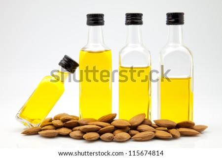almond oil bottles on white fund
