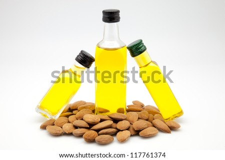almond oil bottles on white fund