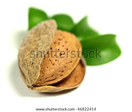 Almond on white background, low depth of focus - stock photo