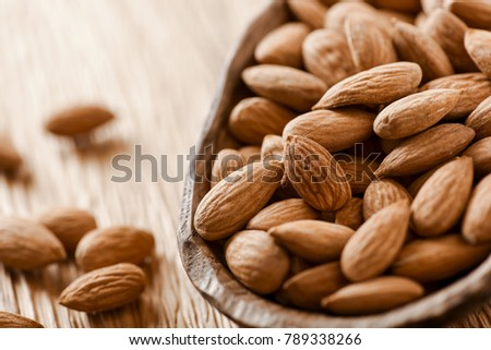 Almonds background. Almonds in wooden bowl. Fresh raw Almond with mint leaf. #789338266