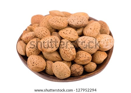 almonds in a bowl on a white background