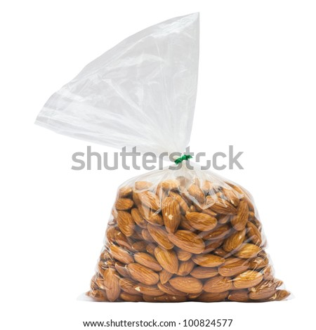 Almonds in plastic bag isolated on white with clipping path