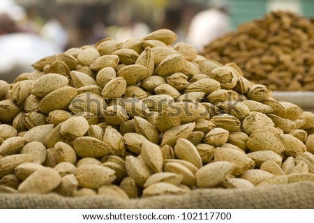 Almonds in their shells at a market in Delhi, India