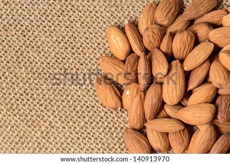 Almonds on a Burlap Background