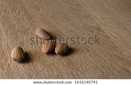 Almonds on brown wooden background. Almonds Healthy food. Vegetarian food