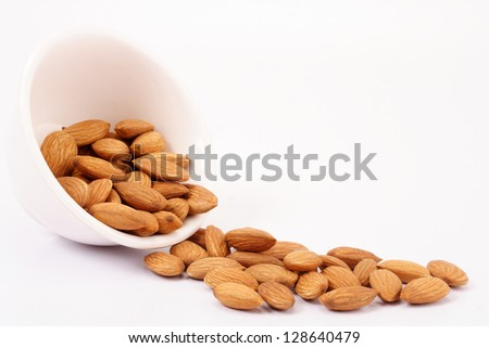 Almonds spilling on white