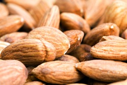 almonds that are used for food and for cooking various dishes, hard raw ready to eat almonds, Golden colored nuts useful and rich in protein and minerals almonds, close up