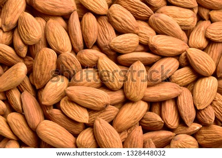 Almonds top view for background, texture #1328448032