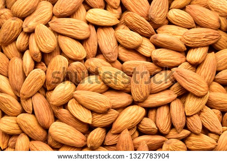 Almonds top view texture, background, dry fruit also called as badam. #1327783904