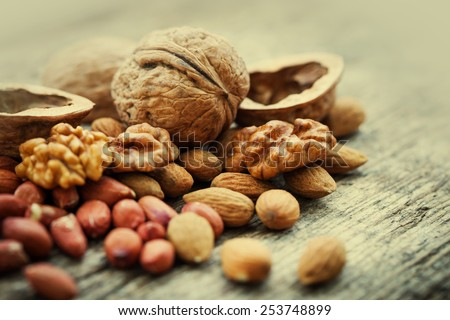 Shutterstock Almonds, walnuts and hazelnuts on wooden table / assortment of nuts