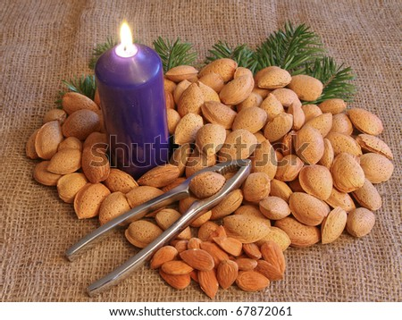 almonds with candle and nutcracker