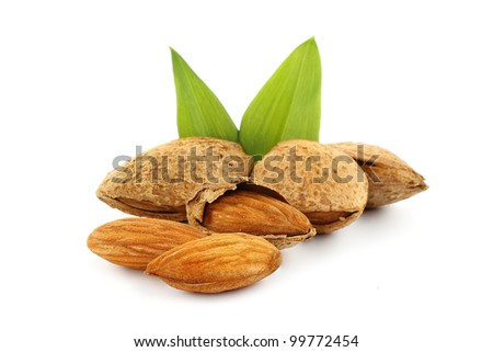 Almonds with green leaves on a white background